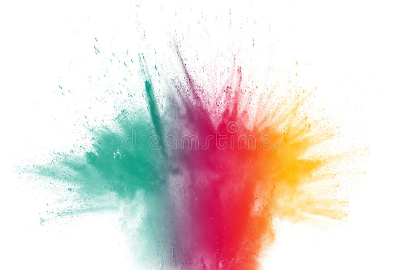 Multicolored powder explosion on white background.Launched colorful particles on background royalty free stock photography