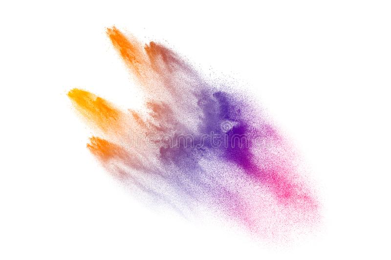 Multicolored powder explosion on white background.Launched colorful particles on background royalty free stock image