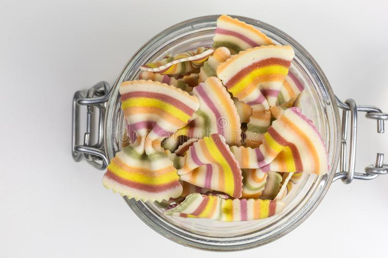 Raw pasta in a glass jar royalty free stock image