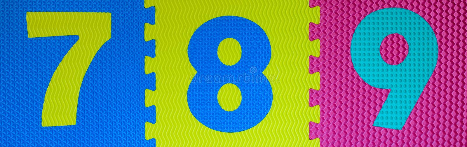 Multicolored Rubber Digits 2. Cut Out Digits Of Toy Rubber Puzzle. Multicolored Playground For Kids royalty free stock image