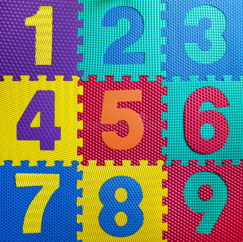 Multicolored Rubber Digits 1. Cut Out Digits Of Toy Rubber Puzzle. Multicolored Playground For Kids stock photography