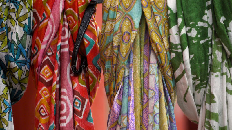 Row of multicolored, patterned scarves royalty free stock photo