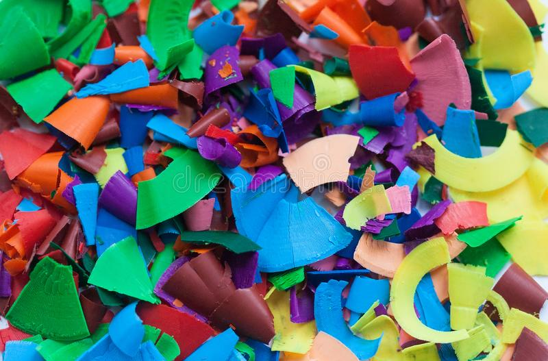 Multicolored shavings of wax pencils stock image