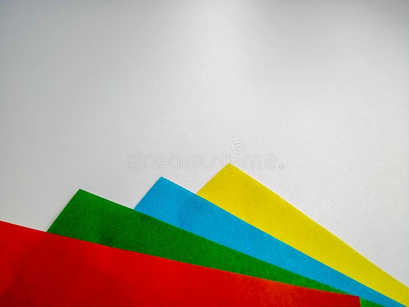 Multicolored sheets of paper on a white background stock image