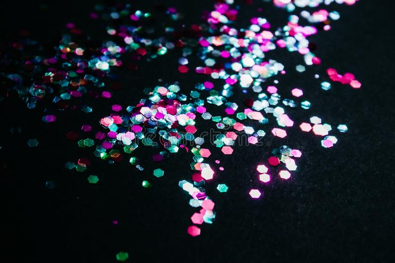Multicolored shiny confetti stock images