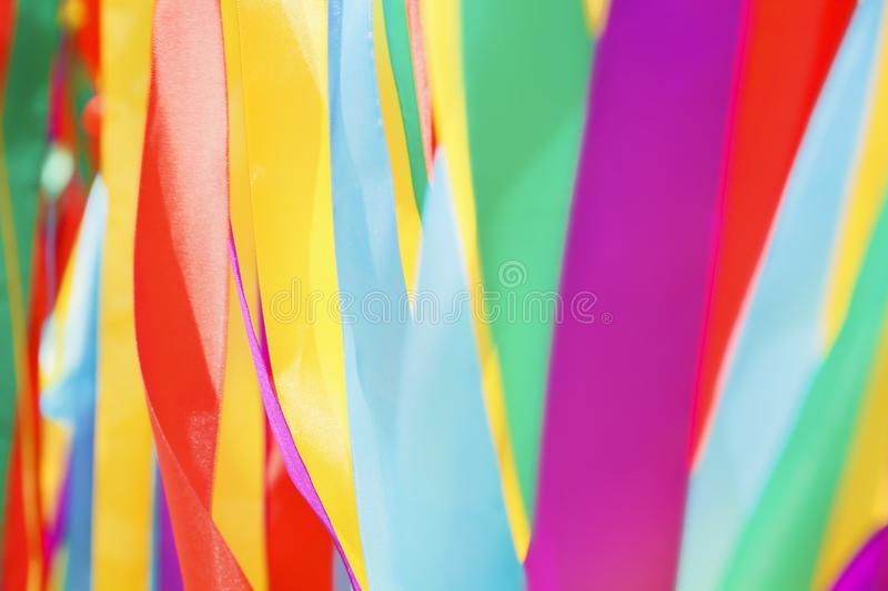 Multicolored silk ribbons are heard in the wind. Background image stock images