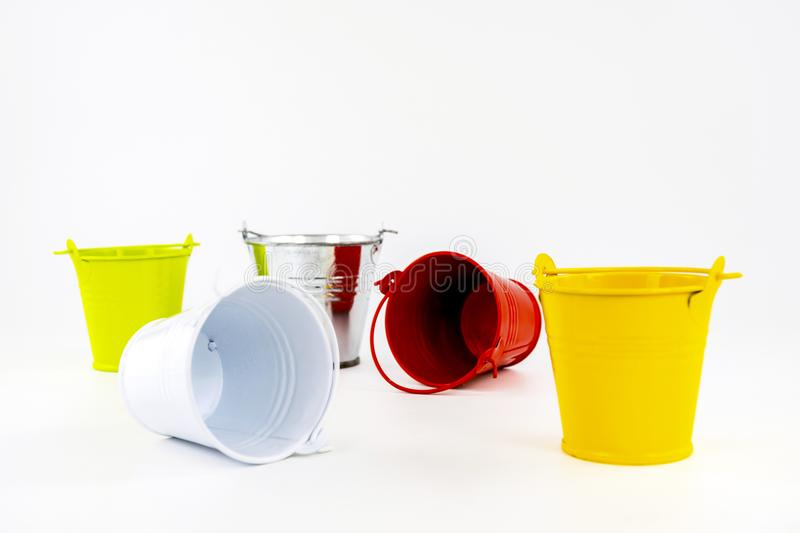 Multicolored small buckets on a white background. Table decorating item stock image