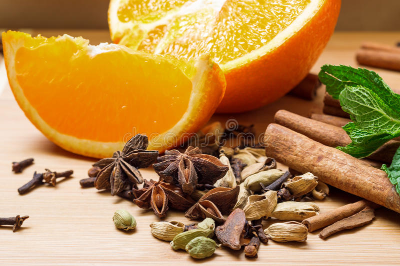 Multicolored spice with orange closeup royalty free stock images