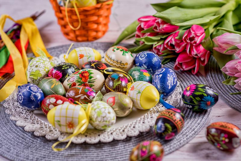 Multicolored spring tulips and Easter eggs with decorations royalty free stock image
