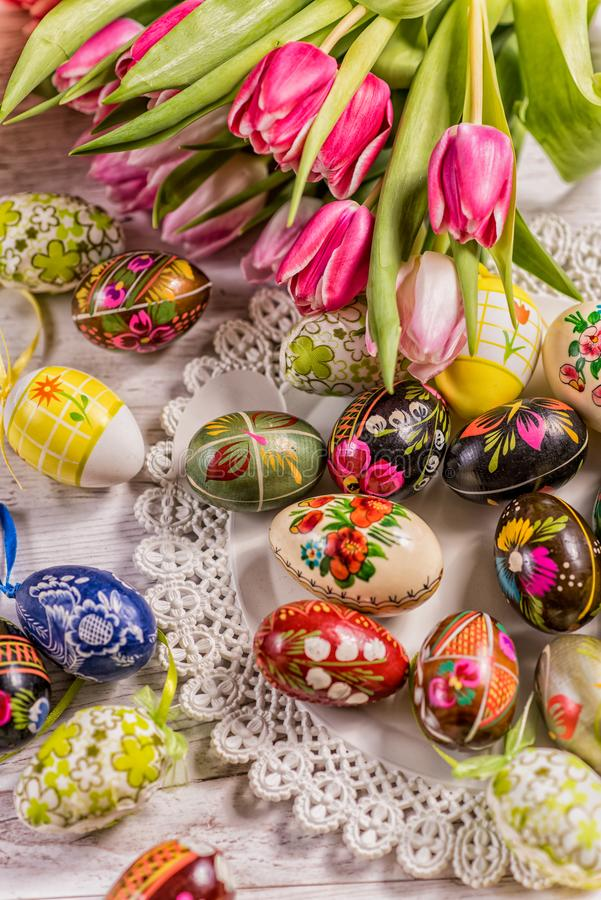 Multicolored spring tulips and Easter eggs with decorations stock images