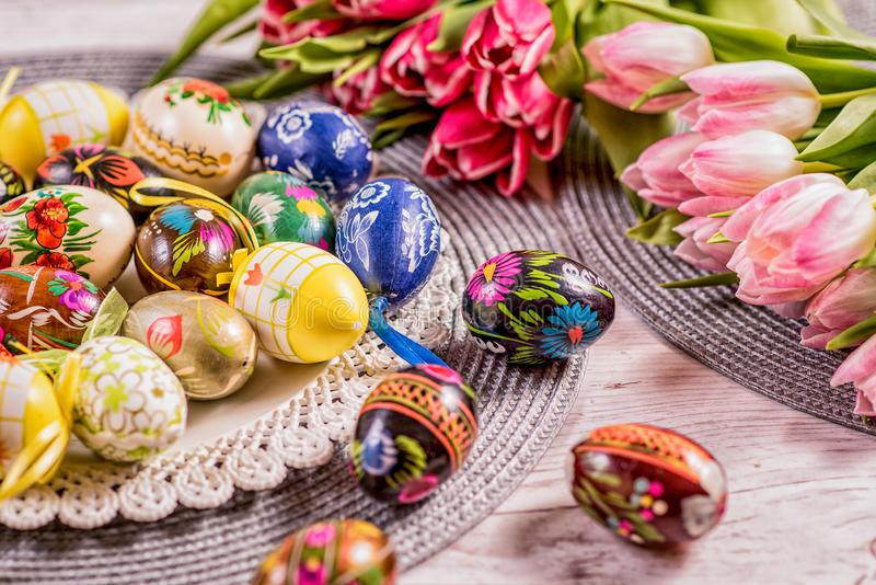 Multicolored spring tulips and Easter eggs with decorations royalty free stock images