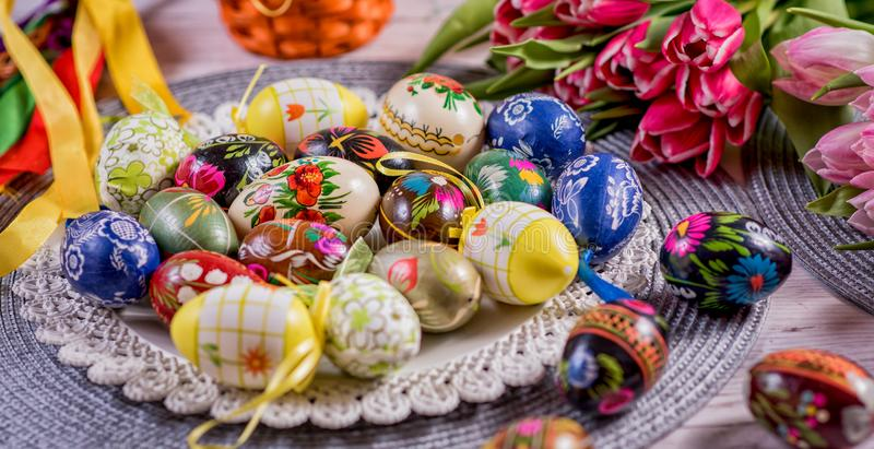 Multicolored spring tulips and Easter eggs with decorations stock photography