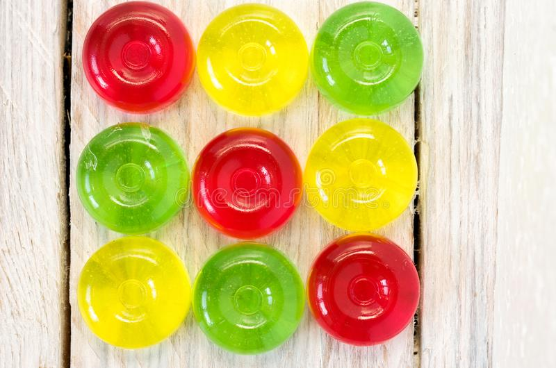 Multicolored square of sugar candies. Three rows and three columns. Background and texture. royalty free stock images