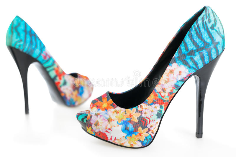 Multicolored stiletto shoes on white. Pair of multicolored stiletto shoes on white background royalty free stock image