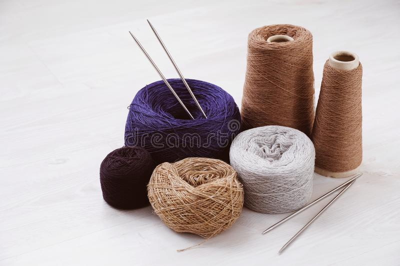 Multicolored threads, skeins and tangles of Italian wool yarn, knitting needles on a white isolated background. The concept of knitting, needlework, handmade royalty free stock photos