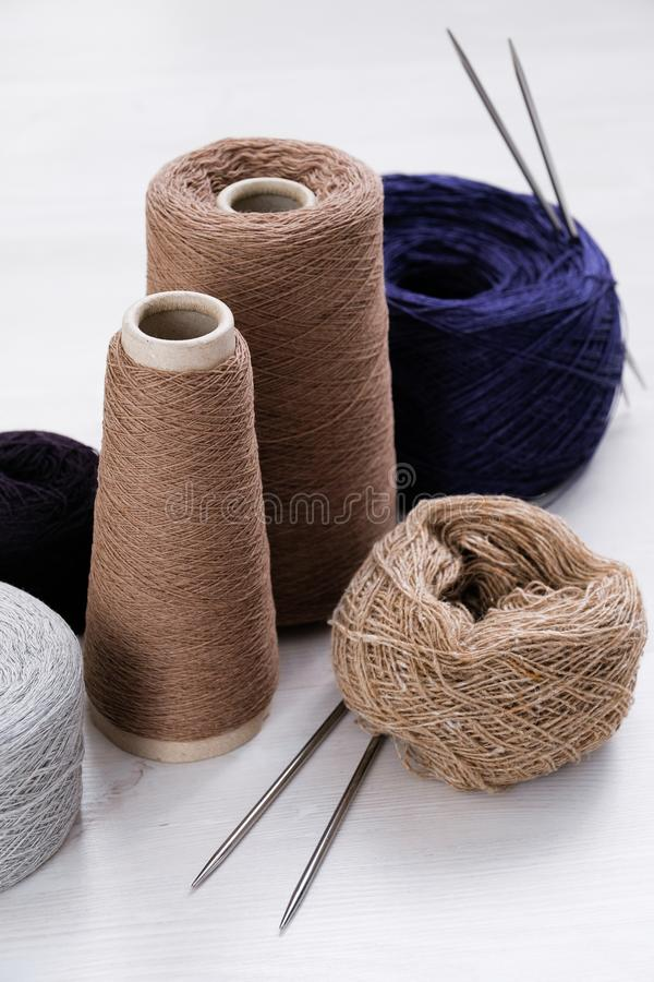 Multicolored threads, skeins and tangles of Italian wool yarn, knitting needles on a white isolated background. The concept of. Knitting, needlework, handmade royalty free stock image