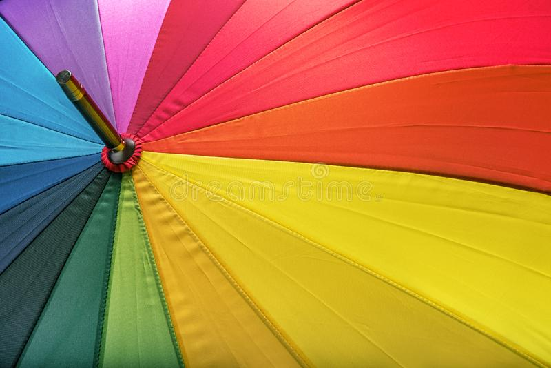 Multicolored umbrella as a background image. Multicolored cool umbrella as a background image stock photos