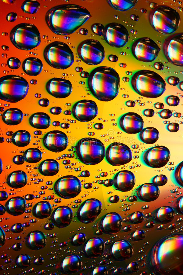 Multicolored waterdrops royalty free stock photos