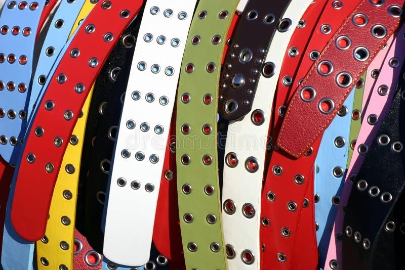 Multicolored women's belts stock photo