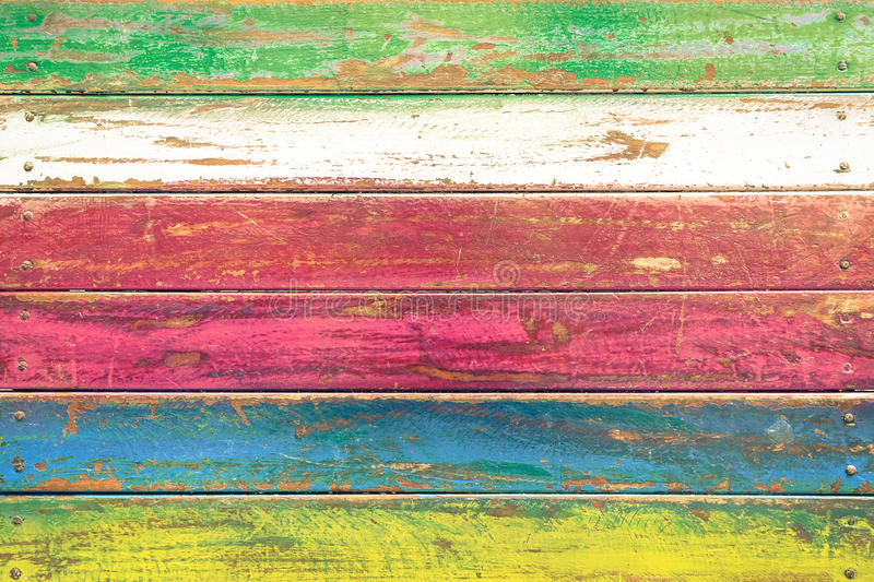Multicolored wood background - Vintage wallpaper pattern. Multicolored wood background and alternative construction material - Texture on wooden table in royalty free stock photography