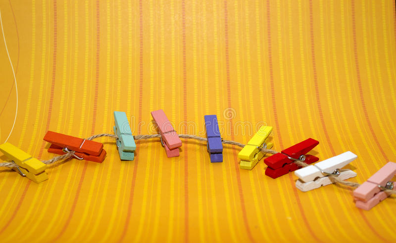 Multicolored wood pegs royalty free stock photos