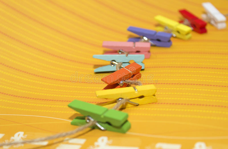 Multicolored wood pegs royalty free stock images