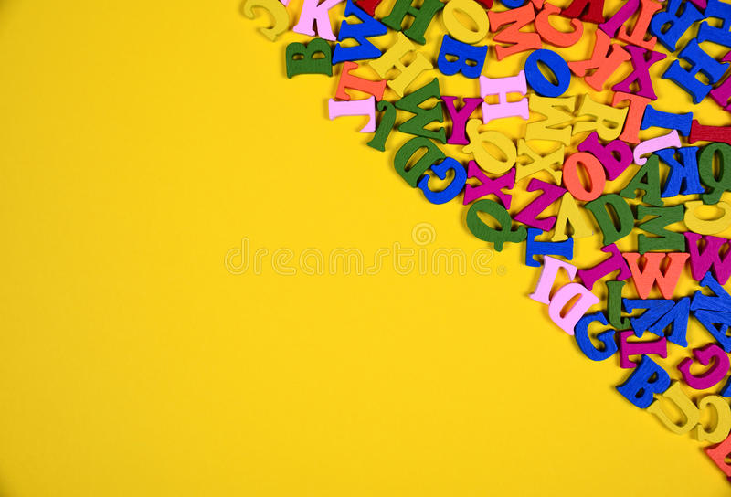 Multicolored wooden letters of the English alphabet stock photos