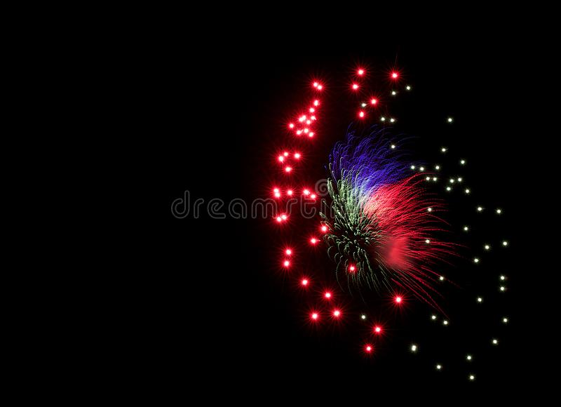 Multicolorful fireworks in black background with space for text in the left,artistic fireworks in Malta,Malta fireworks festival i royalty free stock image