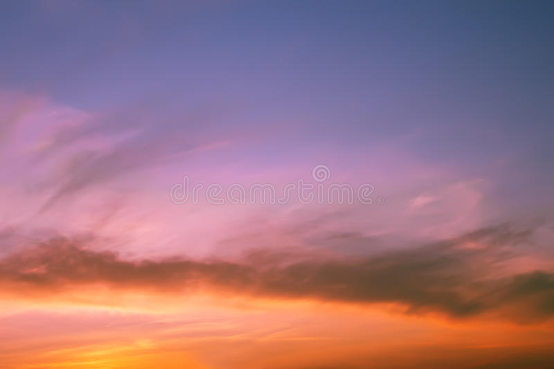 Multicolour clouds at sunset royalty free stock images