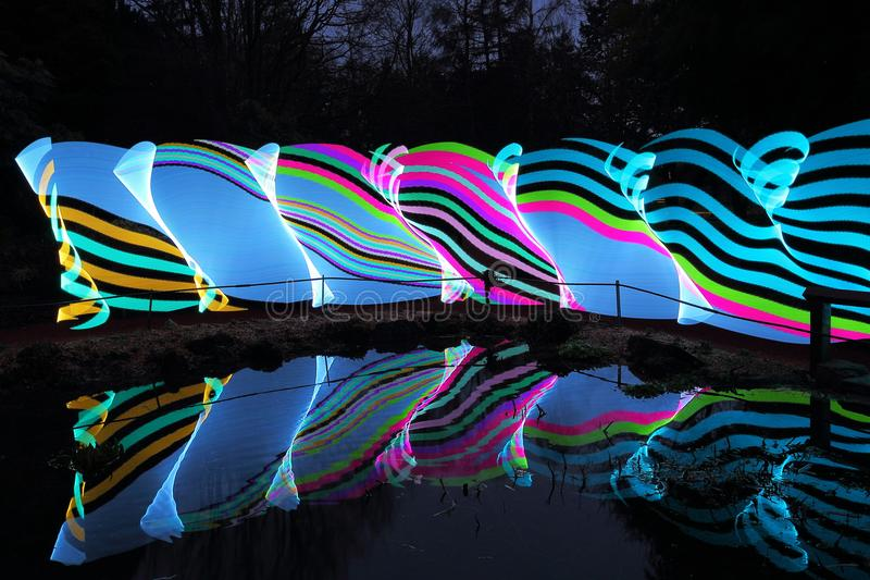 Multicolour Ribbon. Produced using the Pixelstick in Scotland UK by light painting techniques in the evenings just at dusk and after dark stock photo