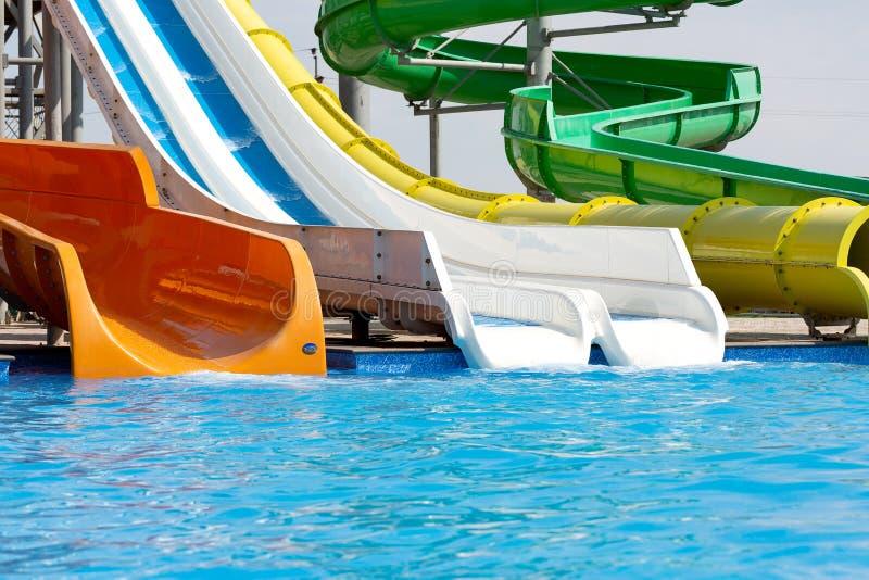 Multicoloured big water slide in the public swimming pool. Multicoloured big water slide in the public swimming pool stock photography