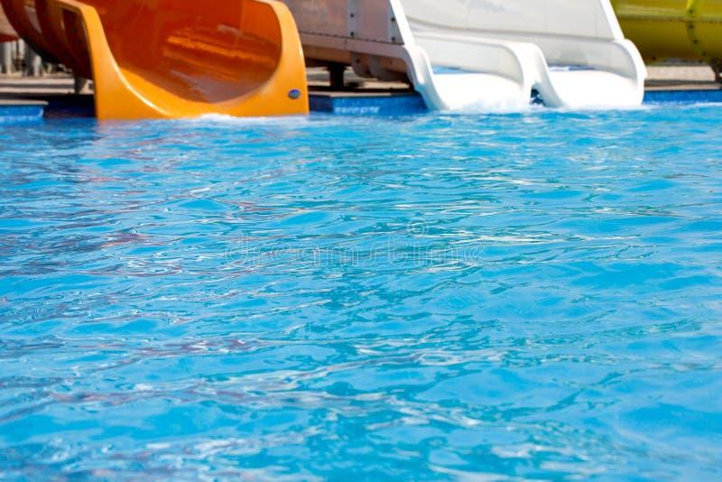 Multicoloured big water slide in the public swimming pool. Multicoloured big water slide in the public swimming pool royalty free stock photo