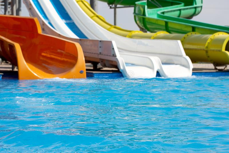 Multicoloured big water slide in the public swimming pool. Multicoloured big water slide in the public swimming pool royalty free stock image