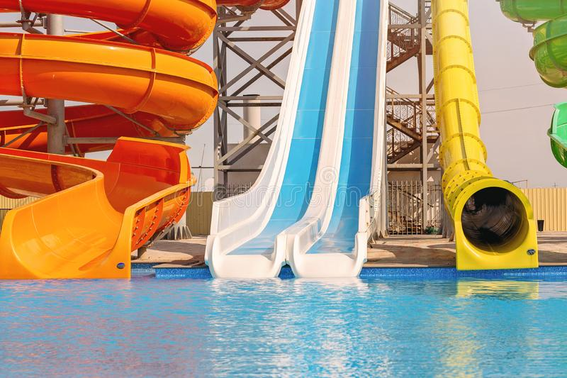 Multicoloured big water slide in the public swimming pool.Sun light. Multicoloured big water slide in the public swimming pool royalty free stock photos