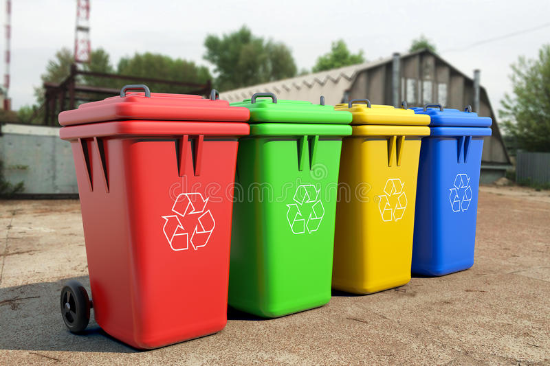 Multicoloured Garbage Trash Bins. Over industrial background stock photo