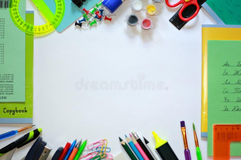 Multicoloured school and office items frame background. A background of multicoloured school items organized in a frame royalty free stock photos