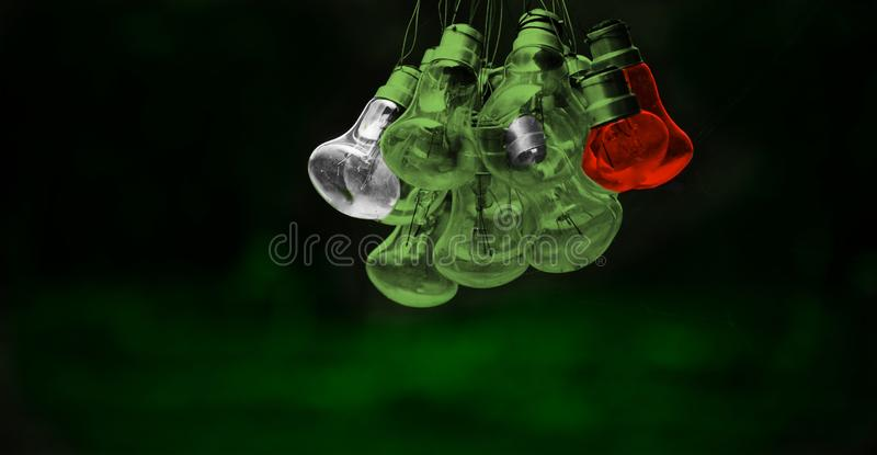 Multicoloured stack of incandescent light bulbs. Hanging in a place unique royalty free image stock image