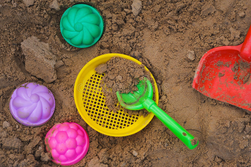 Download Multicoloured Toy Lying On A Wet Sand Stock Image - Image of bright, play: 31625205