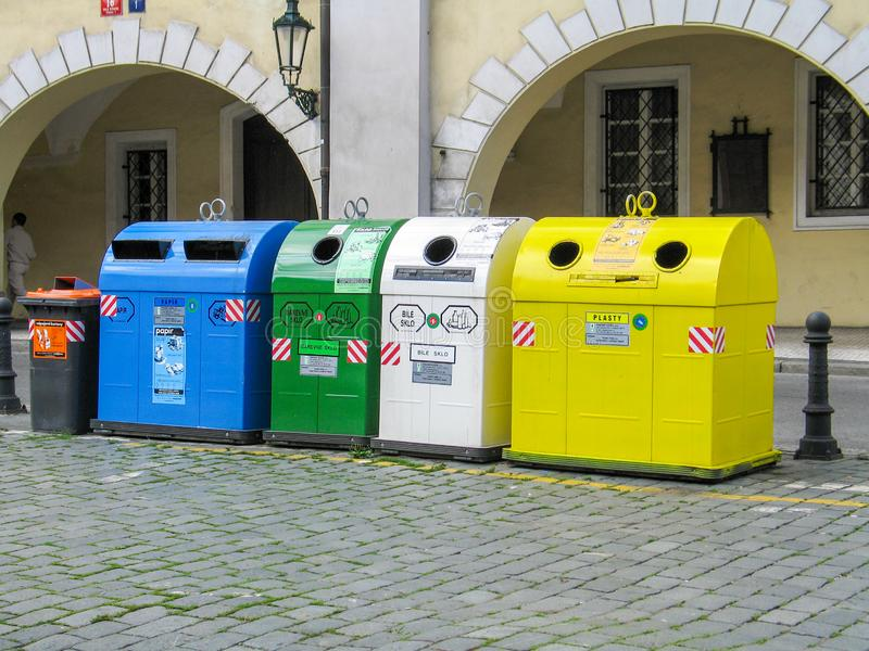 Multicoloured Trash boxes for different garbage sorting and recycling in Prague (On boxes writed \'Glass\', \'Paper\', \'Plastic stock images