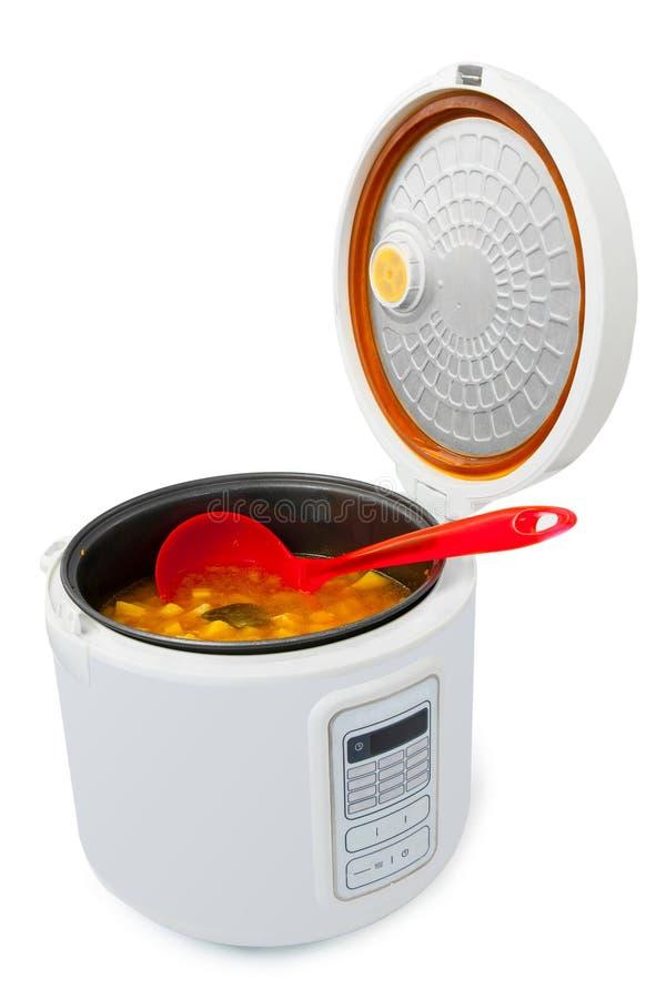 Multicooker met voedsel stock afbeeldingen