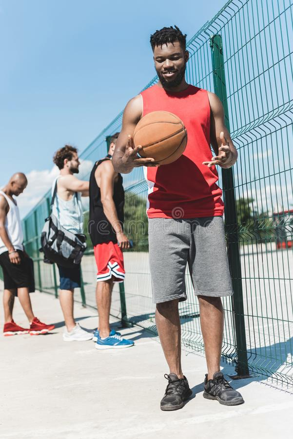 multicultural basketball team spending time stock image