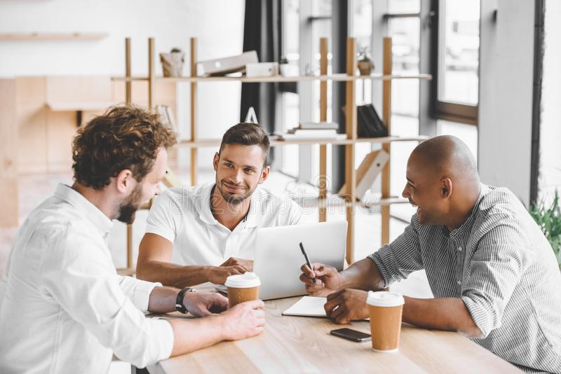 multicultural business people working on laptop at meeting royalty free stock images