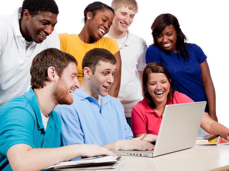Multicultural College Students around a computer. Multicultural College students, male and female, gathered around a computer stock photography