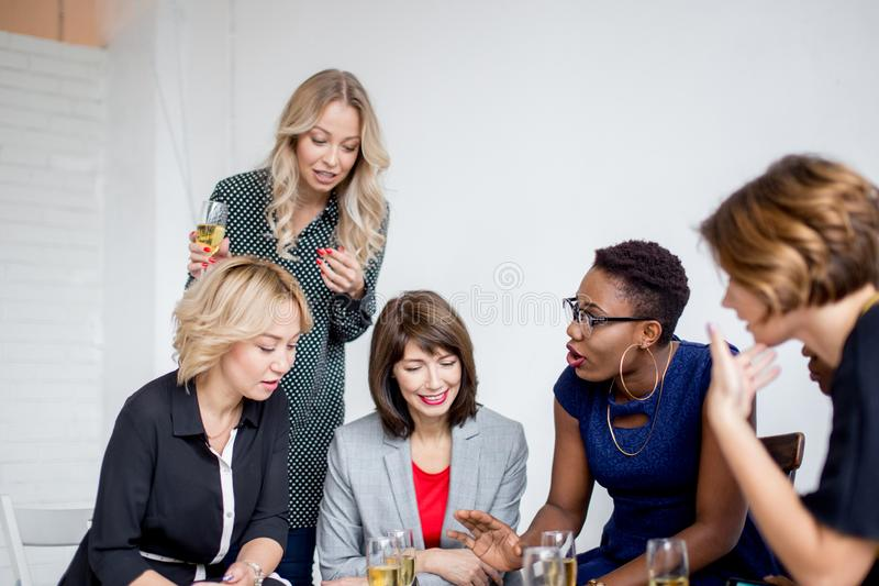 Females coworkers celebrating successful start-up of a new project royalty free stock photos
