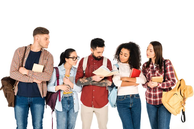 multicultural group of people looking at book in hands of handsome man  isolated stock photo