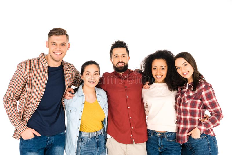 multicultural group of young people smiling and hugging isolated stock photography