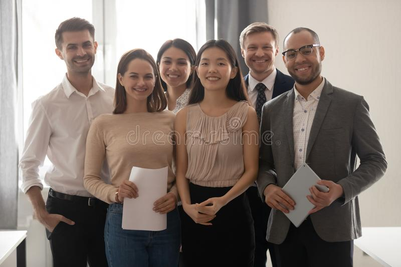 Multicultural professional work team happy employees group looking at camera stock image