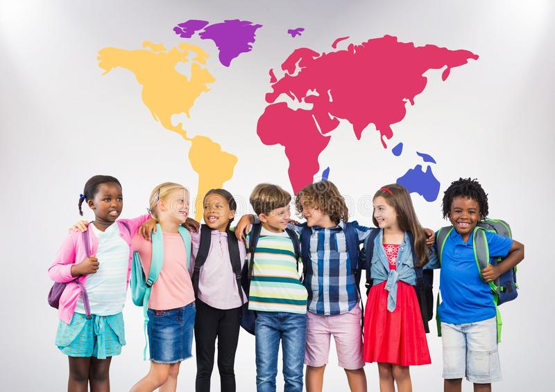 Multicultural School kids in front of colorful world map royalty free stock images