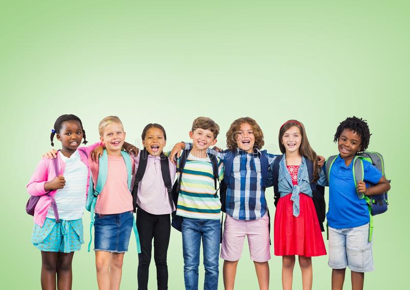 Multicultural School kids in front of green background stock photos