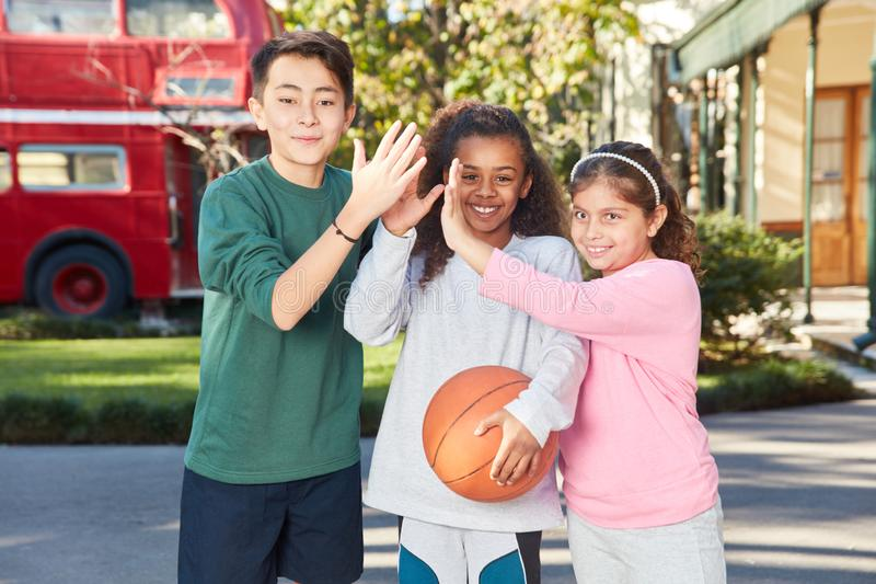 Multicultural students with basketball stock photos